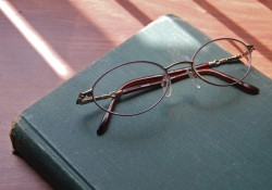 Glasses resting on a closed book
