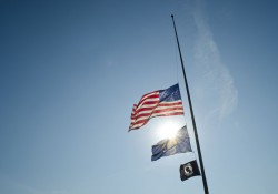 Flags fly at half staff on KCC's North Avenue campus in Battle Creek.