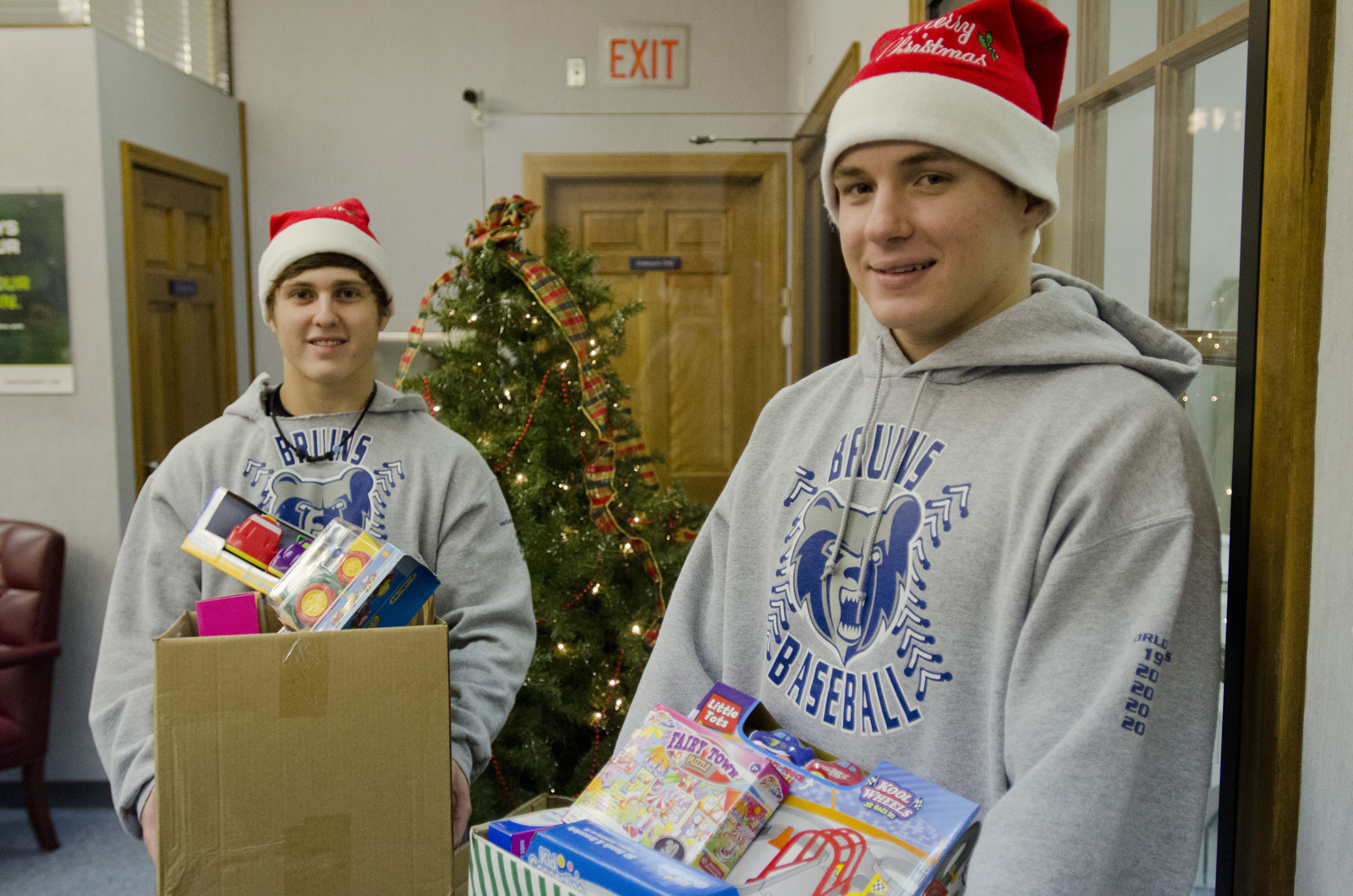 Members of the baseball team drop off toys donated to the Toys for Tots program at Independent Bank on Dec. 6, 2012.