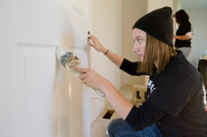 A Bruins Give Back participant paints the interior of a Habitat for Humanity house in Battle Creek in December 2012.