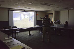 Rob Miller, manager of the Police Academy at KCC, demonstrates the use of the MILO training system during a recent Law Enforcement Advisory Committee meeting at at the college.