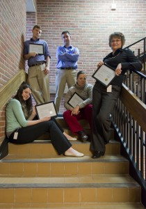 Members of KCC's Public Information and Marketing Department pose with their awards.