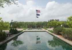 American flag over pools