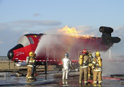 Firefighters train using KCC's ARFF Trainer
