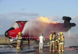 Firefighters train using KCC's ARFF Trainer