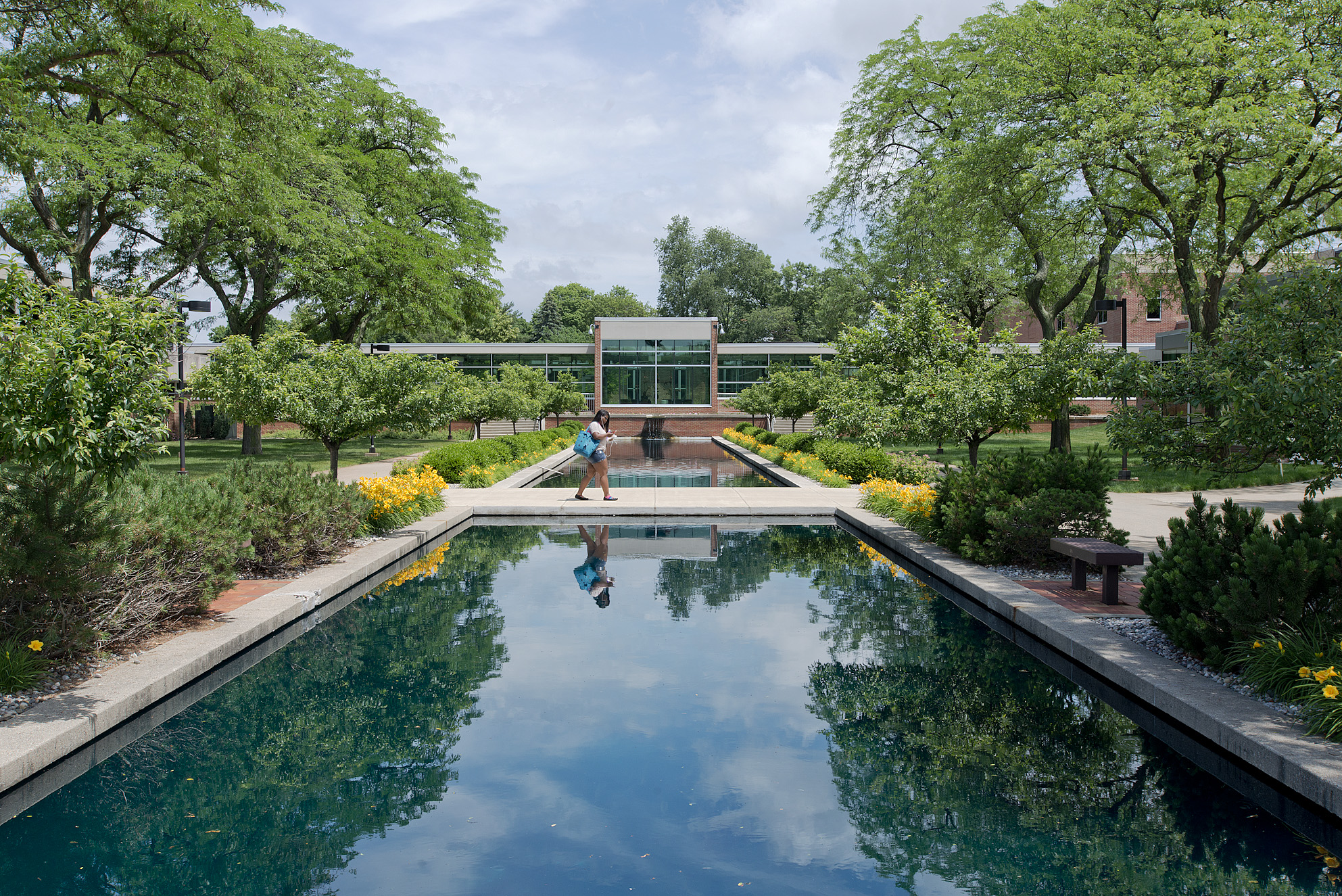 KCC student Kapri Smith walks between reflecting pools on the North Avenue campus.