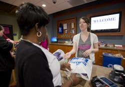 A student makes a purchase at KCC's Bruin Bookstore on Monday, Aug. 19, 2013, the first day fall semester books were available at the bookstore.