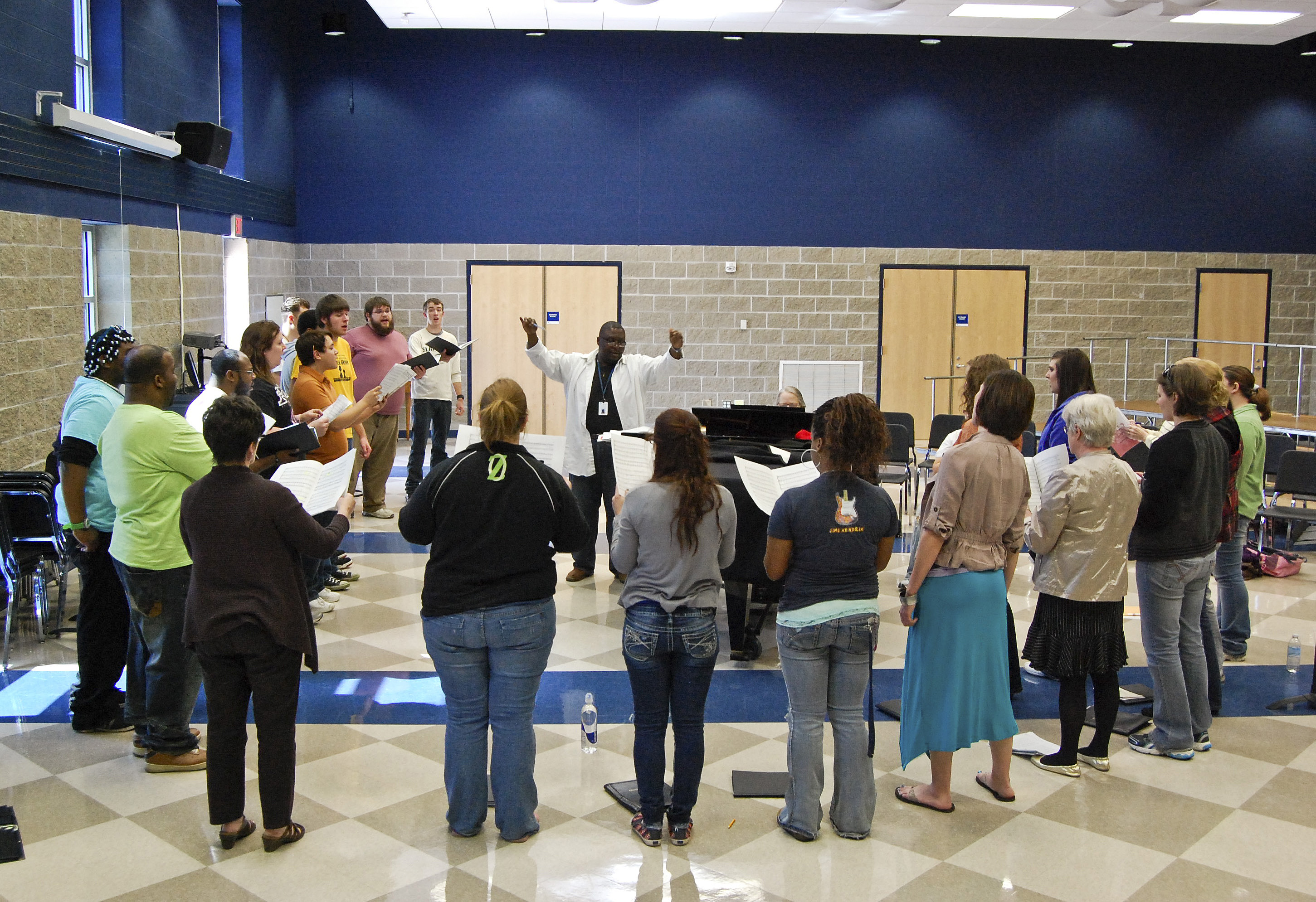 Choir singers rehearse at the Music Center