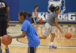 Youth basketball campers dribble during drills at a youth basketball camp in KCC's Miller Gym.