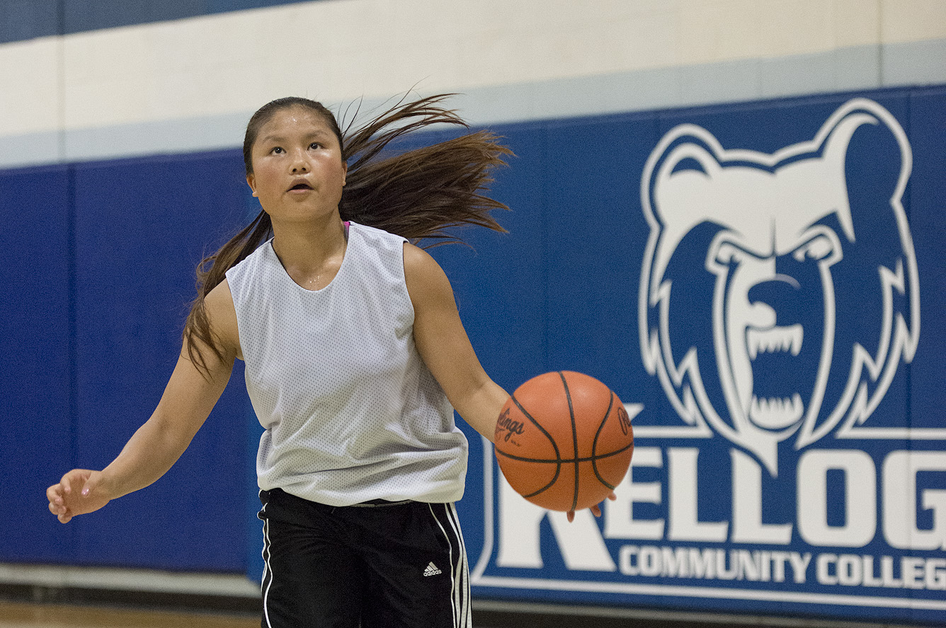 A basketball camp participant dribbles a basketball in the Miller Gym.