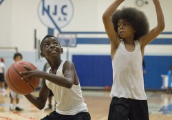 Kids participate in a summer youth basketball camp at KCC's Miller Gym