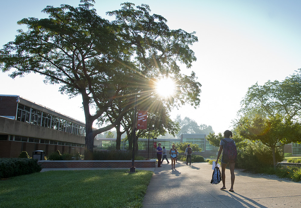 Students walk to morning classes past the reflecting pools outside of the North Avenue campus in Battle Creek