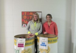 KCC student-athletes pose with food donated for the Food Bank.