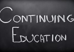 """The words """"continuing education"""" writing in chalk on a blackboard"""