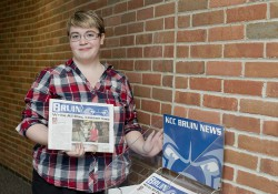 A student delivering the Bruin student newspaper.