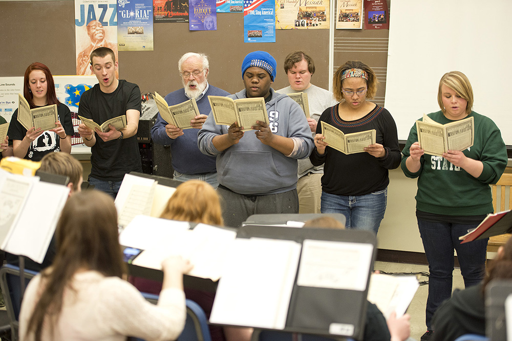 Members of the KCC choirs rehearse during their annual retreat