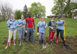 KCC students and staff pose while breaking ground for the College's new community garden.