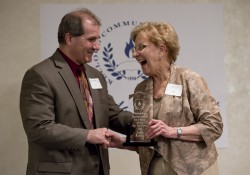 Music student Janis Emery accepts an award from KCC President Dr. Dennis Bona during the 2014 Awards Banquet.