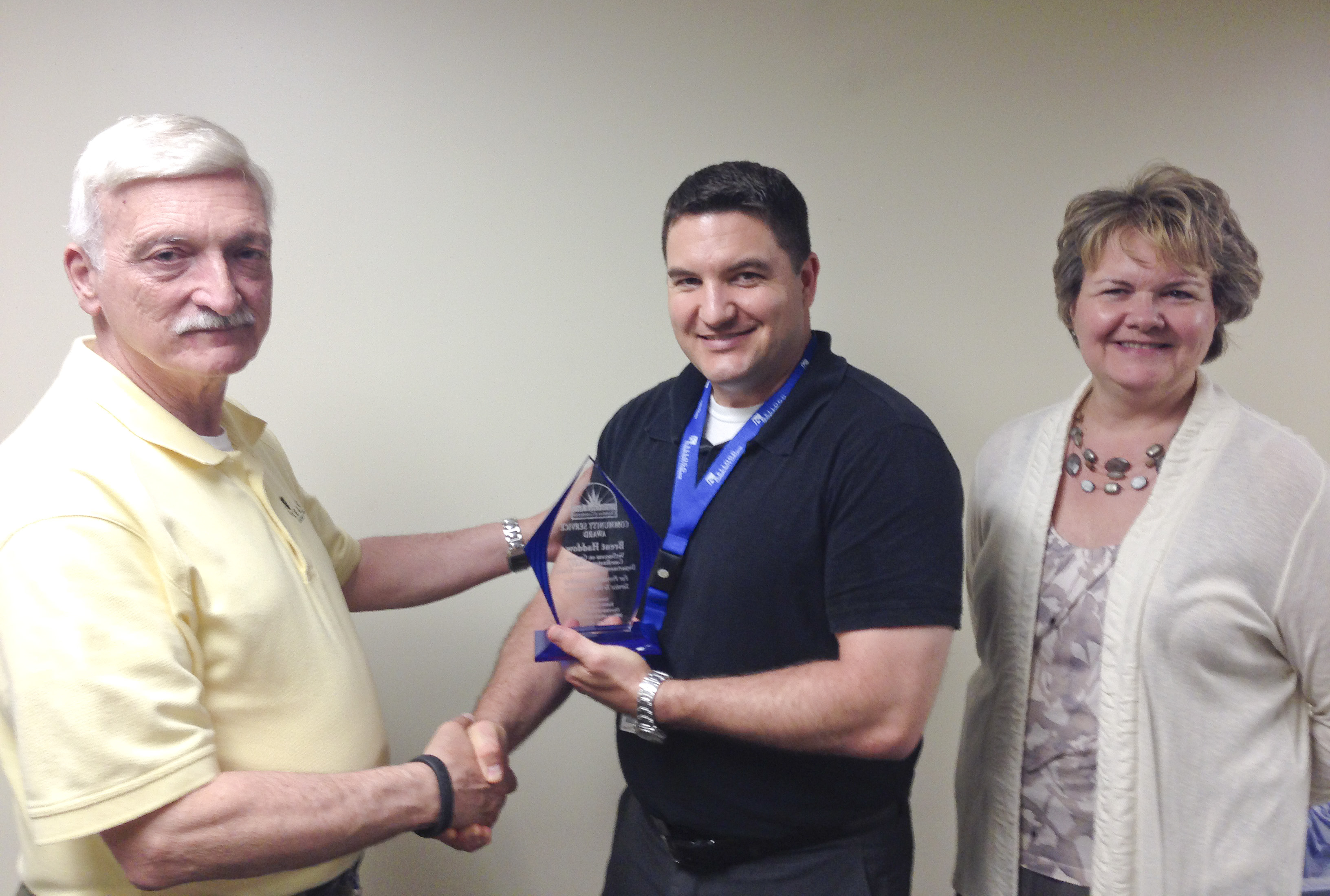 Brent Haddow, a VetSuccess on Campus veterans counselor, accepts an award.