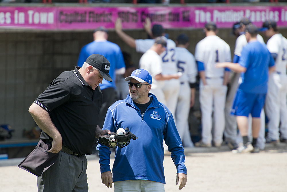 KCC Athletic Director Tom Shaw speaks to an umpire during a KCC baseball game at C.O. Brown Stadium.