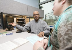 An academic advisor works with a student.