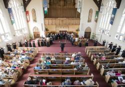 KCC choir members perform in a church in Battle Creek.