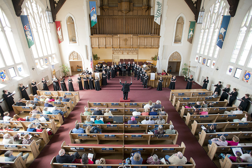 KCC choir members perform in a church in Battle Creek.