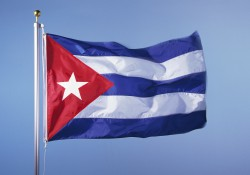 Stock image of a Cuban flag flying in the wind.