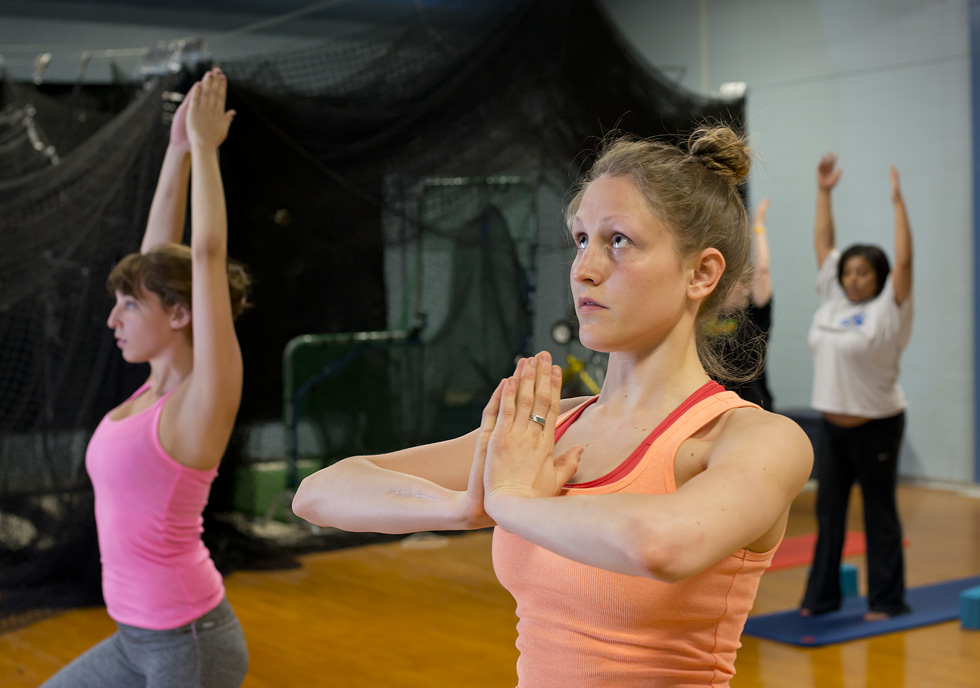 Students do yoga during class at the Miller Gym