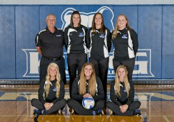 Volleyball sophomores pose with their coaches