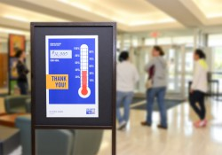 United Way sign with a thermometer graphic showing KCC is nearly halfway to the College's goal of raising $16,000.