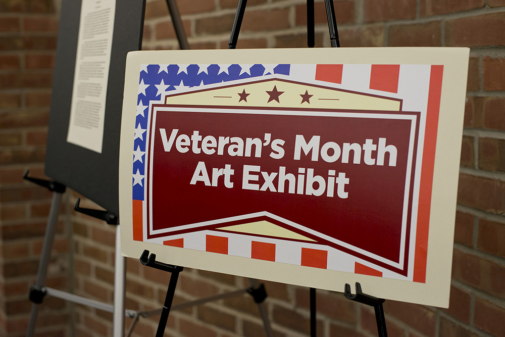 A sign for the Veteran's Month Art Exhibit.