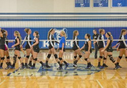 The women's volleyball team shakes hands with the opposing team after a match at the Miller Gym.
