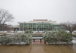 An exterior view of the Binda Theatre while it's snowing outside.