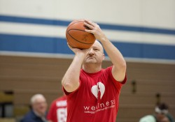 Athletic Director Tom Shaw sets up a shot during a charity basketball game at the Miller Gym.