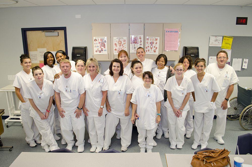 CNA students pose for a group photo in class.