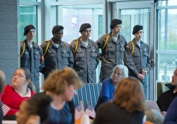 Soldiers stand during a Veterans Day ceremony in the Student Center at KCC