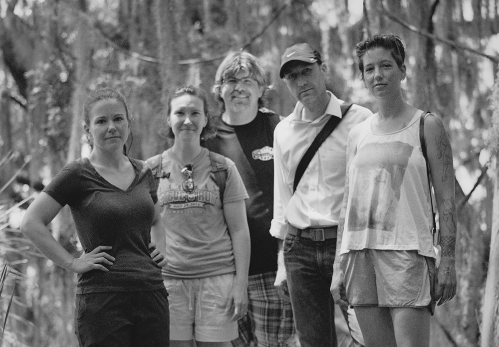 """A group photo of the five photographers whose work is featured in the """"Low Country Revisited"""" exhibit at KCC."""