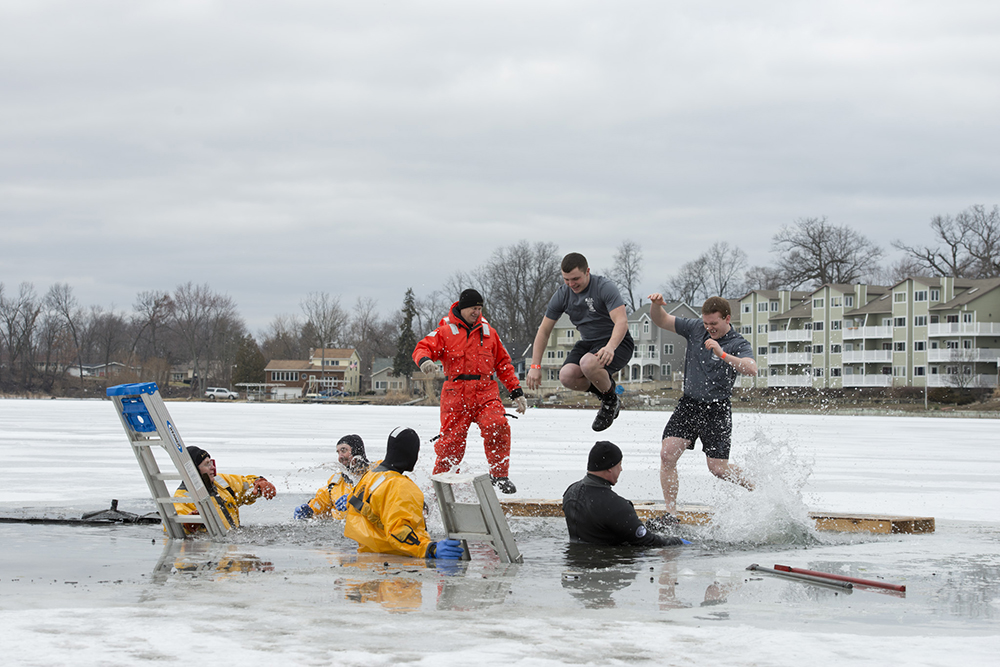KCC students participate in the Battle Creek Polar Plunge by jumping into the water of a frozen lake.