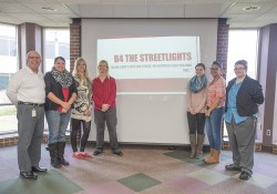 SERV 299 students pose for a group photo after a presentation in the Spring Lake Room