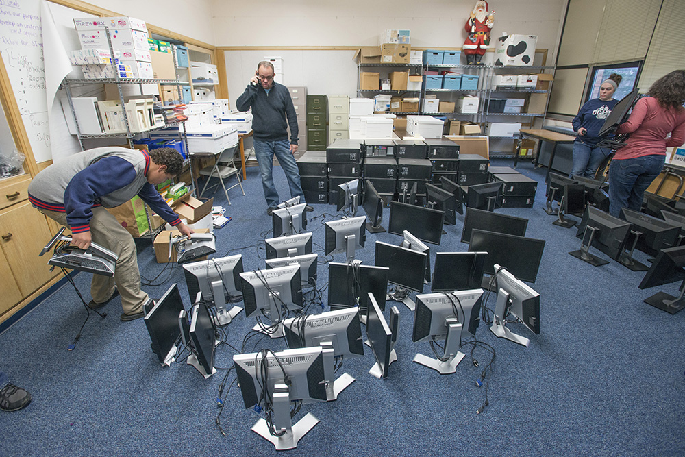 Calhoun Community High School students stand around computers donated by KCC