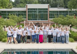 A group photo of the 2014 cohort of KCC Foundation Gold Key and Trustee scholars, taken outside in between the reflecting pools on campus in Battle Creek.