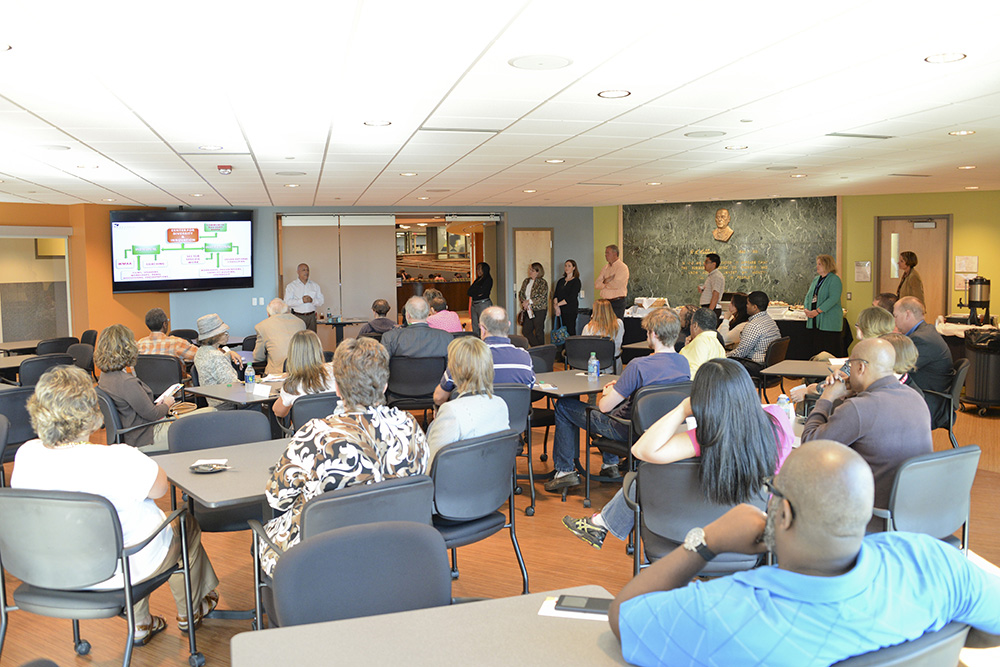 Jorge Zeballos, executive director of the KCC Center for Diversity and Innovation, addresses an audience during an open house in the Kellogg Room.