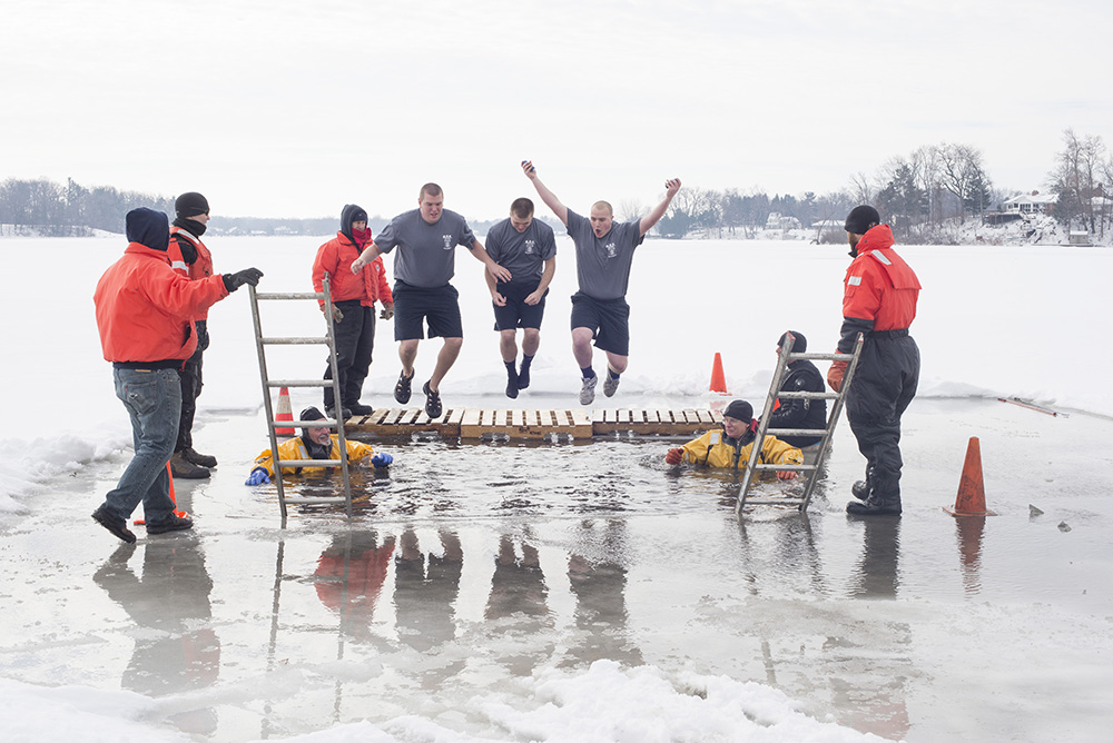 KCC Police Academy cadets jump into the waters of a frozen lake during the 2015 Battle Creek Polar Plunge.
