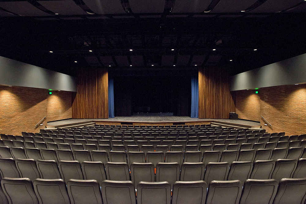 A view of an empty Binda Performing Arts Center looking toward the stage over audience seating