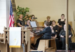 Adjunct faculty member and pianist Kathy Cary plays the organ during a choir event at a church in downtown Battle Creek.