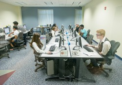Students take tests on computers in the Testing and Assessment Center on the North Avenue campus
