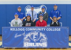 KCC's 2015 class of high school senior baseball commits pose with the KCC baseball coaches in the Miller Gym.