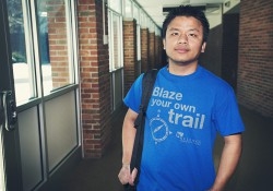 Trustee Scholarship recipient Hlum Khim poses for a photo in a hallway on the North Avenue campus.