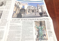 A photo of a Battle Creek Enquirer article in the newspaper about KCC's trip to Cuba.